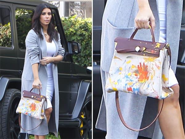 Kim sa Hermes torbom koju je North West sama oslikala (foto: celebuzz)